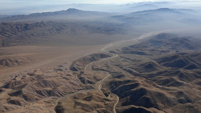 A wash can be seen snaking its way through the Mojave Desert landscape northeast of the Coachella Valley.