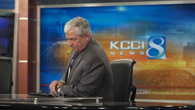 KCCI anchor Kevin Cooney reflects after reporting the evening news at the KCCI news building in Des Moines, Thursday, Nov. 5, 2015. Cooney will retire later this month.