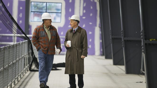 Dan Bree, owner and a partner in the Pinnacle Athletic Complex, and Dave DeJoy, an accountant and adviser, walk around the building earlier this week. The facility opens Saturday.