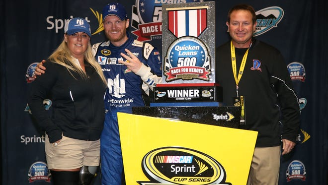 Stephanie Decker, left, stands with Dale Earnhardt Jr. Sunday night in Victory Lane.