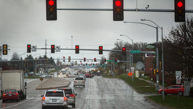 Synchronized traffic lights turn red while heading southbound on Jordan Creek Parkway towards Jordan Creek Town Center in West Des Moines, Wednesday, Nov. 18, 2015.