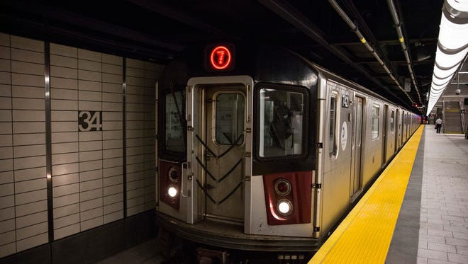 A New York subway train arrives at a station.