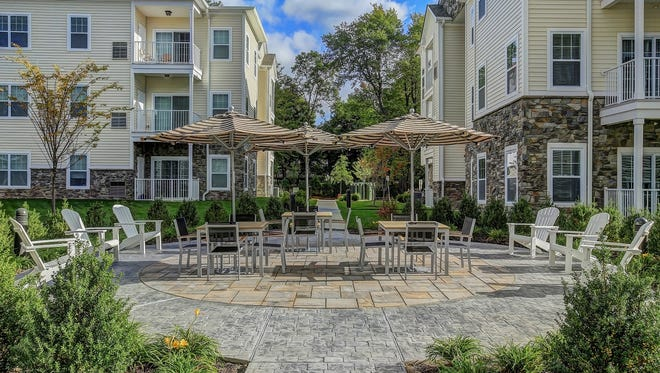 The courtyards at the Hillside Club in  Livingston include outdoor tables for dining and relaxation.