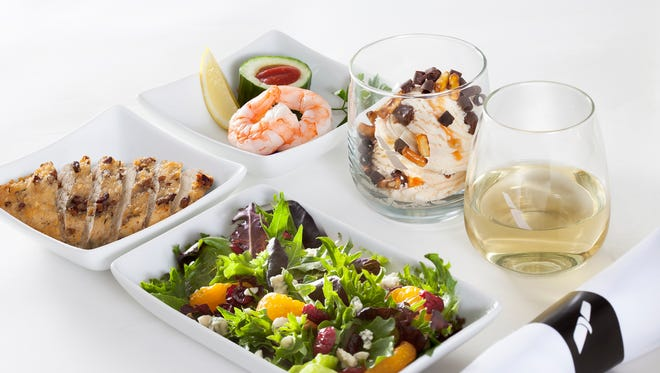 U.S. airlines have been upgrading their in-flight menus, like this lunch served in premium cabins on American Airlines.