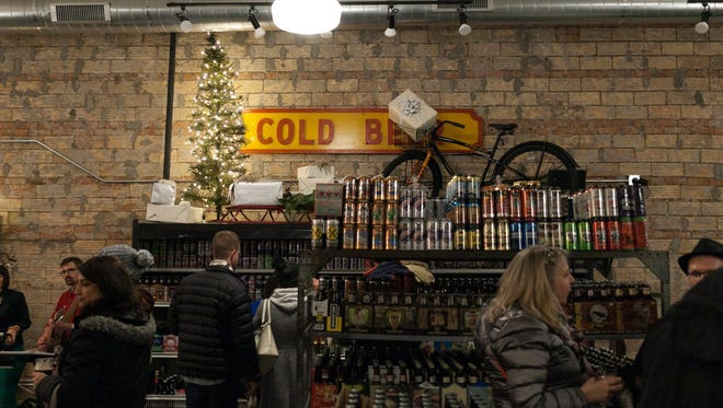 8 Degrees Plato Detroit is a beer store specializing in craft and imported brews that features a 16 tap bar, the venue was a participant in the 43rd edition of Detroit's Noel Night along Woodward Avenue and adjacent streets in Midtown on Saturday, Dec. 5, 2015.