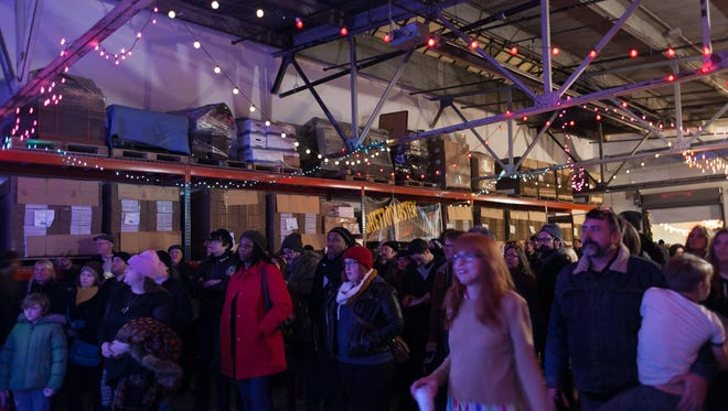 Detroit-based band Bronze Radio Return headlined the lineup at the Motor City Brewing Works event during the 43rd annual Noel Night on Saturday, Dec. 5, 2015.