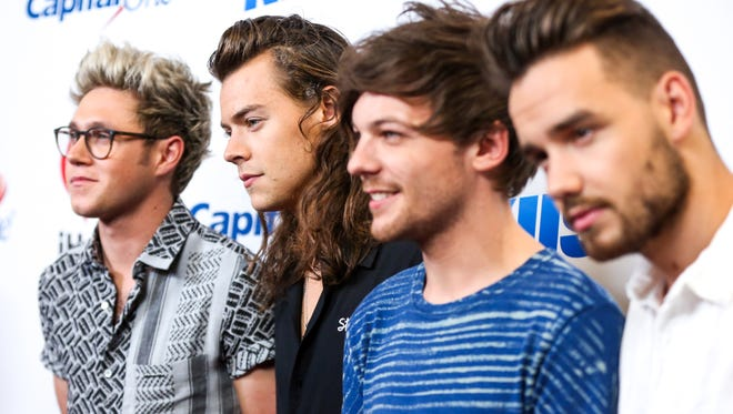 FILE - In this Friday, Dec. 4, 2015, file photo, Niall Horan, from left, Harry Styles, Louis Tomlinson and Liam Payne of One Direction arrive at 102.7 KIIS FM's Jingle Ball iHeartRadio at Staples Center in Los Angeles. Messages of love and gratitude shared by the boy band One Direction topped Twitter's charts this year, eclipsing President Barack Obama's celebration of the U.S. Supreme Court's decision legalizing gay marriage. One Direction members accounted for half of the 10 most recirculated tweets, including the three most popular.  (Photo by Rich Fury/Invision/AP, File)