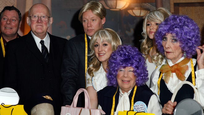 Nicholas Smith (l) attends a 'You Are Being Served' charity sale of designer goods owned by the late Wendy Richard, his fellow cast-member of 'Are You Being Served?', at Selfridges on Jan. 19, 2010 in London.