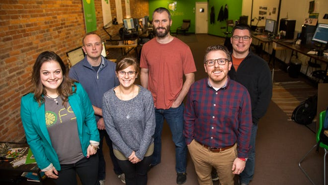 The FreshySites team, front from left, Kelsey Moore, Emily Risboskin, Ben Giordano, back row, Keith Dubuque, John Fuller, and Tim Burford, inside the company's store on Court Street in Binghamton.