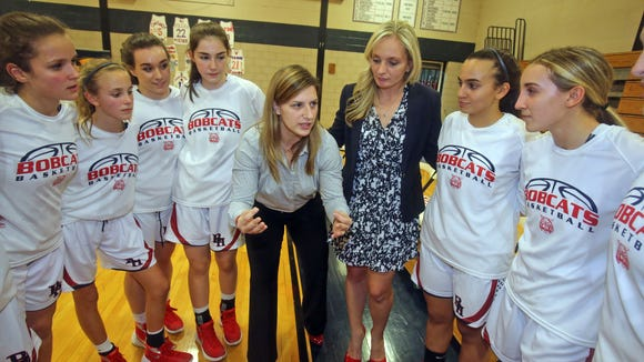 Byram Hills girls basketball coach Alyse La Padula, speaks to her players before a game against White Plains at Byram Hills High School in Armonk Dec. 11, 2015.  Next to her is assistant coach Albana Krasniqi  La Padula was a soccer player at Purchase College while Krasniqi coached there.