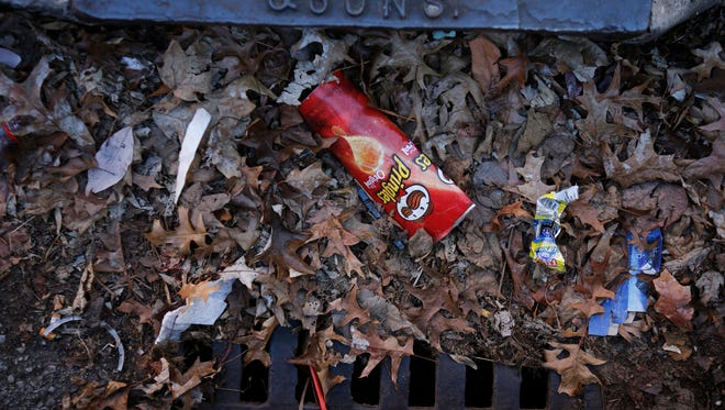Garbage and leaves collect in a drain in the 2500 block of West Chestnut. The majority of residents polled in a University of Louisville survey, initiated by the Louisville Metro Police Department, say they worry more over nuisances than crime.