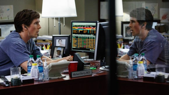 Michael Burry (Christian Bale) works at his desk in