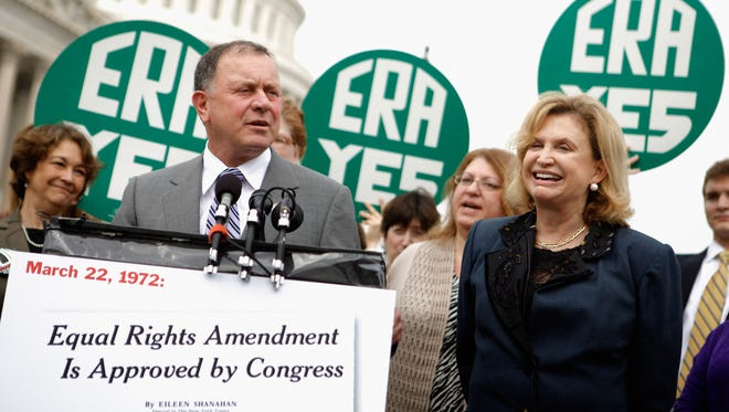 Rep. Richard Hanna, R-NY, joined Rep. Carolyn Maloney, D-NY. and representatives of women's groups during a rally to mark the 40th anniversary of congressional passage of the Equal Rights Amendment outside the U.S. Capitol March 22, 2012.