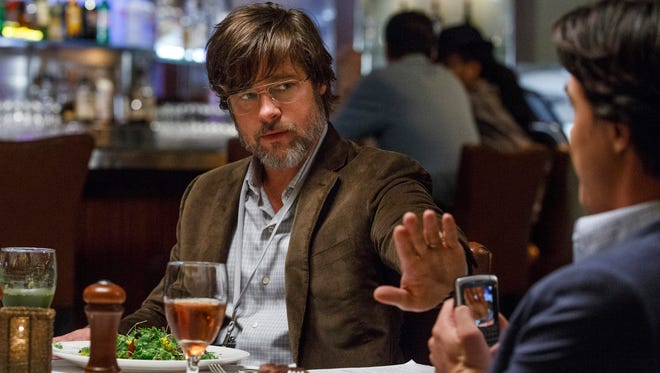 """This photo provided by Paramount Pictures shows, Brad Pitt, left, as Ben Rickert and Finn Wittrock as Jamie Shipley, in the film, """"The Big Short,"""" from Paramount Pictures and Regency Enterprises. (Jaap Buitendijk/Paramount Pictures via AP)"""