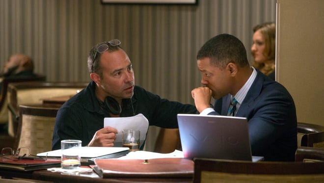 "Will Smith and Peter Landesman in ""Concussion."" The movie opens Friday at Regal West Manchester Stadium 13, Frank Theatres Queensgate Stadium 13 and R/C Movies Hanover."