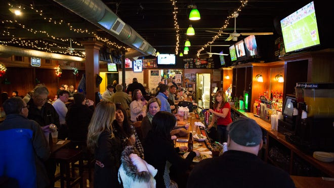 """Patrons celebrate New Year's Eve in Merchants Grill, the location of a suspected terror attack plot, on Dec. 31, 2015. It """"was one of the biggest New Year's Eves we've had,"""" owner John Page said. """"It was kind of a strange day, but we had a lot of people who were big supporters."""""""