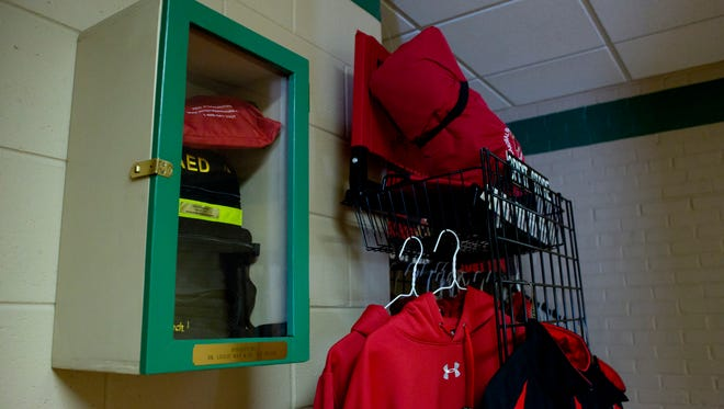 An AED device located in a first floor hallway of the main building Tuesday, Jan. 5, 2016 at Cardinal Mooney High School in Marine City. Senate Bill 647 would require that public and private middle and high schools provide instruction and certification in CPR and the use of an AED device.
