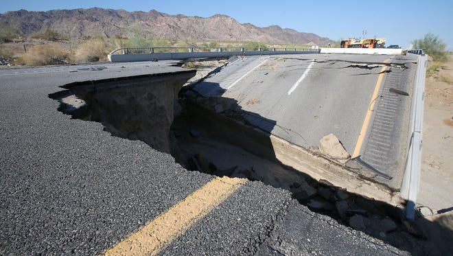 The Tex Wash bridge was washed out by flood waters shutting down Interstate 10 between Coachella and Blythe on Sunday.