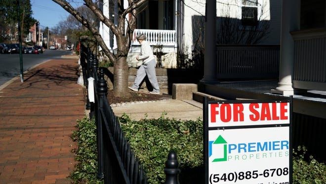 A for sale sign sits outside of a Staunton home on Tuesday, Jan. 5, 2015.