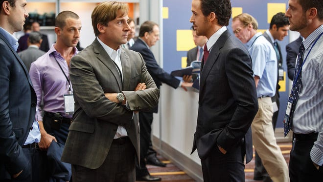 "Rafe Spall, from left, as Danny Moses, Jeremy Strong as Vinnie Daniel, Steve Carell as Mark Baum, Ryan Gosling as Jared Vennett and Jeffry Griffin as Chris in ""The Big Short."""