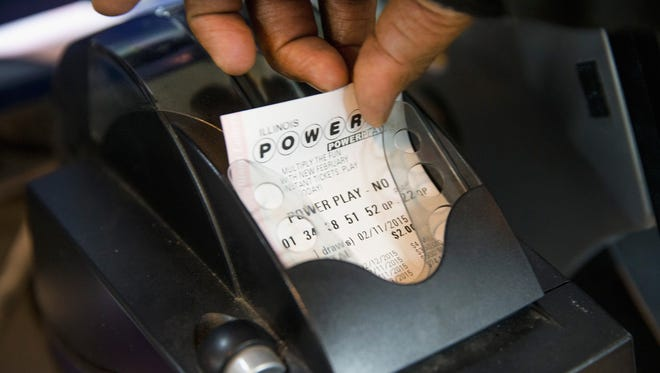 A lottery ticket is printed for a customer at a Chicago 7-Eleven.