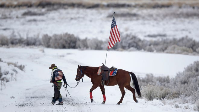Cowboy Dwane Ehmer, of Irrigon, Ore., a supporter of the group occupying the Malheur National Wildlife Refuge, walks his horse Thursday, Jan. 7, 2016, near Burns, Ore. The group has said repeatedly that local people should control federal lands, but critics say the lands are already managed to help everyone from ranchers to recreationalists.