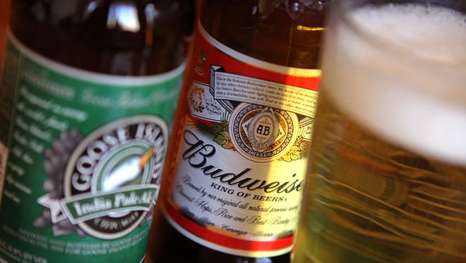 Goose Island's India Pale Ale is pictured with Budweiser beer. Chicago-based Fulton Street Brewery LLC, the maker of Goose Island beers, was acquired by Anheuser-Busch InBev.
