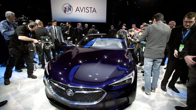 The Buick Avista concept is revealed to the news media on the eve of the 2016 North American International Auto Show.