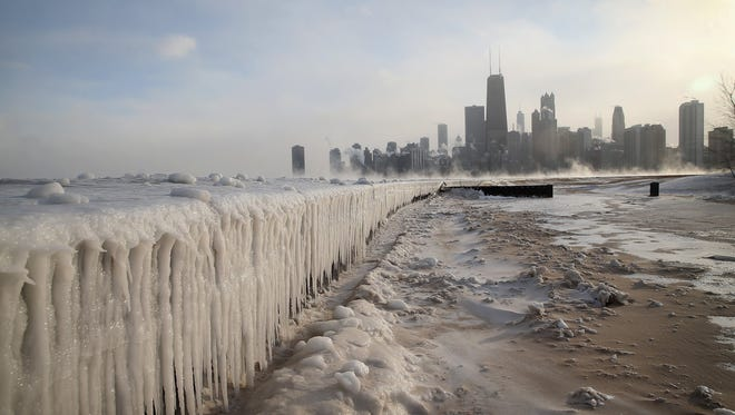 Ice builds up along Lake Michigan at North Avenue Beach as temperatures dipped well below zero on January 6, 2014 in Chicago, Illinois. After two years of very icy conditions on the Great Lakes, they are less than 7% ice covered this January. (Photo by Scott Olson/Getty Images)