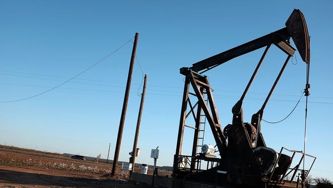 SWEETWATER, TX - JANUARY 19:  An oil pumpjack works on January 19, 2016 in Sweetwater, Texas. Global oil prices continue their downward fall with U.S. oil dropping towards $27 a barrel, its lowest since 2003, on worries about global oversupply. Following a diplomatic agreement on nuclear fuel with America, Iran has forecast it will add 500,000 barrels per day to global production, following the lifting of sanctions.  (Photo by Spencer Platt/Getty Images) ORG XMIT: 600659731 ORIG FILE ID: 505762352