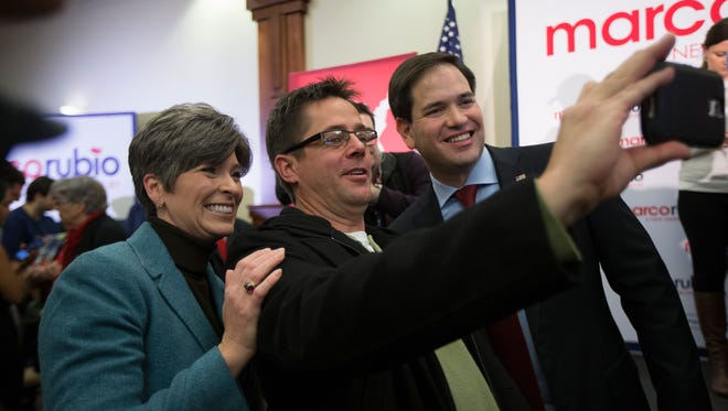 Senator Joni Ernst and Senator Marco Rubio greet supporters during a campaign stop at Forte Banquet Hall in Des Moines, Monday, Jan. 25, 2016.