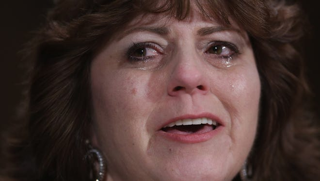 WASHINGTON - Holly's Song of Hope founder Tonda DaRe of Carrollton, Ohio, weeps as she testifies before the Senate Judiciary Committee about the moments after she found her daughter, Holly, overdosed on heroin .