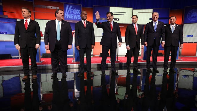 Republican presidential candidates (from left) Ohio Gov. John Kasich, Jeb Bush, Sen. Marco Rubio of Florida, Sen. Ted Cruz of Texas, Ben Carson, New Jersey Gov. Chris Christie and Sen. Rand Paul of Kentuckey gather before the Fox News - Google GOP Debate at the Iowa Events Center in Des Moines, Iowa, on Thursday.