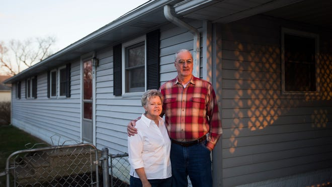 David and Ellen Keith at their home in the Pleasant Ridge neighborhood in Charlestown, Ind. The Keith's have paid off their home and plan on staying in the neighborhood.