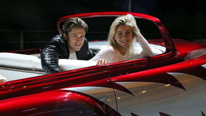 "Aaron Tveit, left, and Julianne Hough rehearse for ""Grease: Live,"" airing live Sunday."