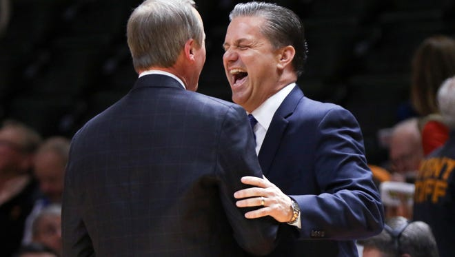 Feb 2, 2016; Knoxville, TN, USA; Kentucky Wildcats head coach John Calipari (right) meets with Tennessee Volunteers head coach Rick Barnes before the game at Thompson-Boling Arena. Mandatory Credit: Randy Sartin-USA TODAY Sports