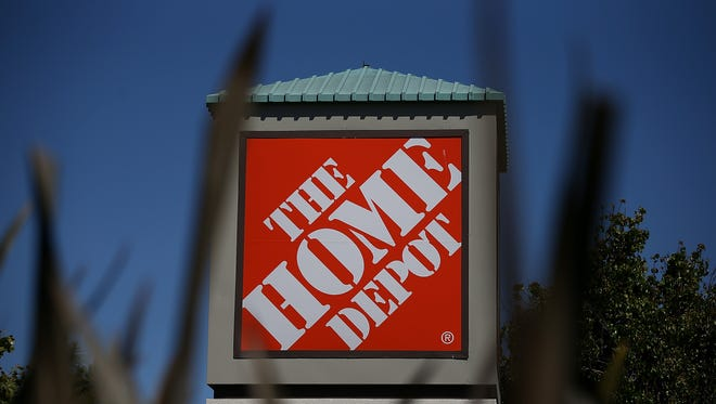 A file photo of The Home Depot sign. The company announced it's plan to hire 300 Reno employees in preparation for its spring sales.