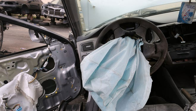 This file photo, taken in 2015, shows a deployed safety airbag in a 2001 Honda Accord at the LKQ Pick Your Part salvage yard in Medley, Florida. A multi-state settlement with American Honda Motor Company Inc. and Honda of America Mfg.Inc. netted the Office of the Attorney General$100,000.