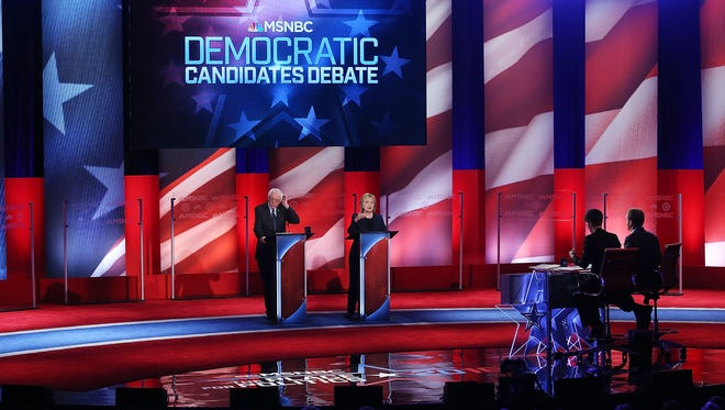Hillary Clinton and Bernie Sanders take part in the MSNBC debate at the University of New Hampshire on Feb. 4, 2016, in Durham, N.H.