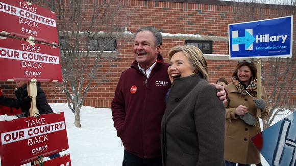 Hillary Clinton poses for a picture with Frank Fiorina, husband of Carly Fiorina, on Tuesday morning.