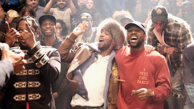 Kanye West, along with Kid Cudi and Pusha T, debuts 'The Life of Pablo' at Madison Square Garden.