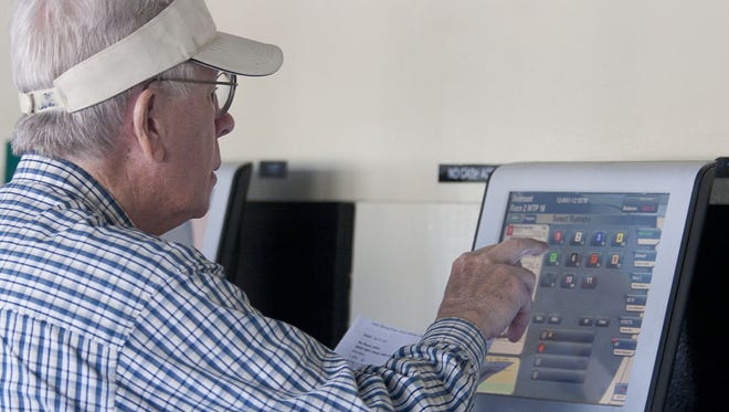 Pat King of Sea Bright places his bet on opening day at Monm outh Park in 2012. The Oceanport racetrack wants to offer sports betting.