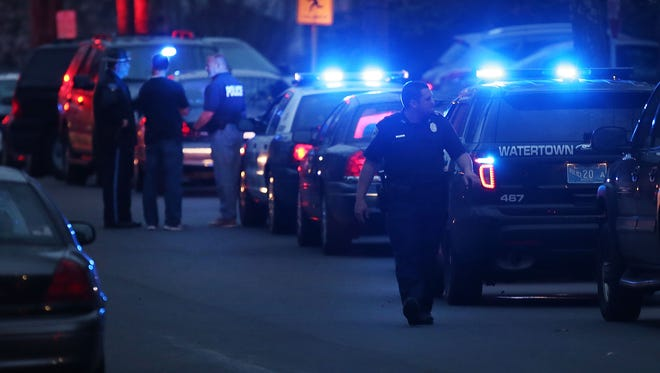 Police converge near the scene where it was believed 19-year-old bombing suspect Dzhokhar A. Tsarnaev  is in hiding on April 19, 2013, in Watertown, Mass.