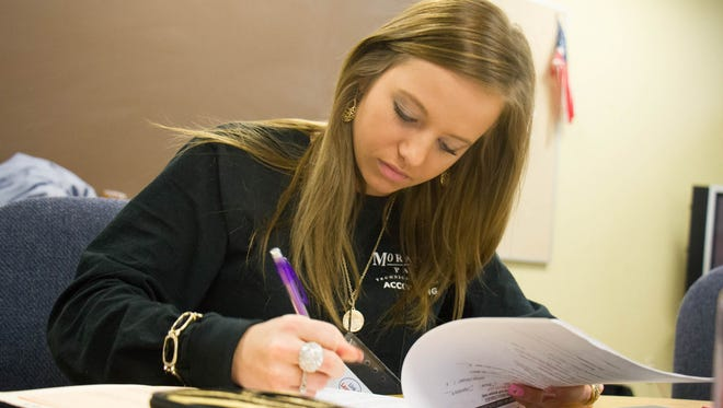 Moraine Park Technical College accounting student Natalie Graff works on a tax return as part of the Volunteer Income Tax Assistance program.