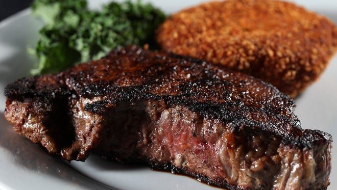The New York Strip with potato cake served at the Cast Iron Steakhouse.