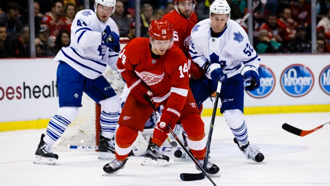 Red Wings center Gustav Nyquist (14) sto in front of Maple Leafs center Nazem Kadri (43) and defenseman Martin Marincin (52) in the first period at Joe Louis Arena Sunday.