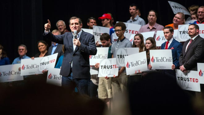 Senator Ted Cruz speaks to an overflowing crowd in the Peoria Civic Center Theater Monday, March 14. The presidential hopeful made a brief stop in Peoria, Ill., just one day before the Illinois primary.