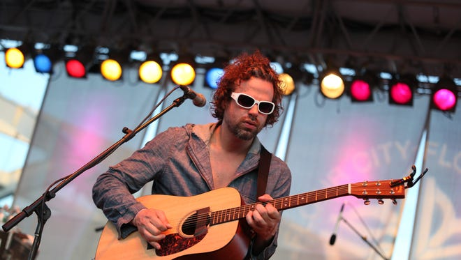 Rusted Root frontman Michael Glabicki, performing herd at a Party in the park show, returns with his band Rusted Root on May 12.