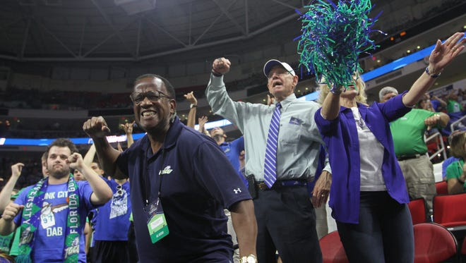 FGCU fans cheer at the close of the first half against UNC in the NCAA tournament on Thursday, March 17, 2016 in Raleigh, NC.