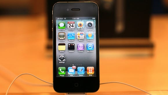 ORG XMIT: 100116014 NEW The iPhone 4 is displayed at